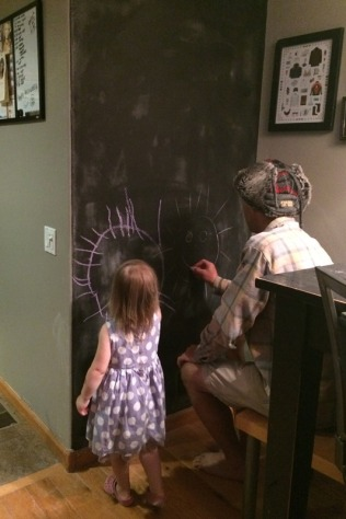 Daddy & Stella christening the wall with it's first drawing!